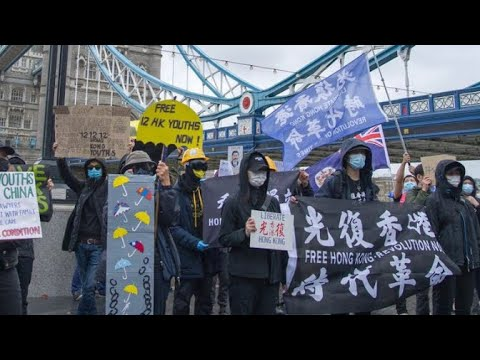 CHINA CALLS PEACEFUL PROTESTERS VIOLENT THUGS